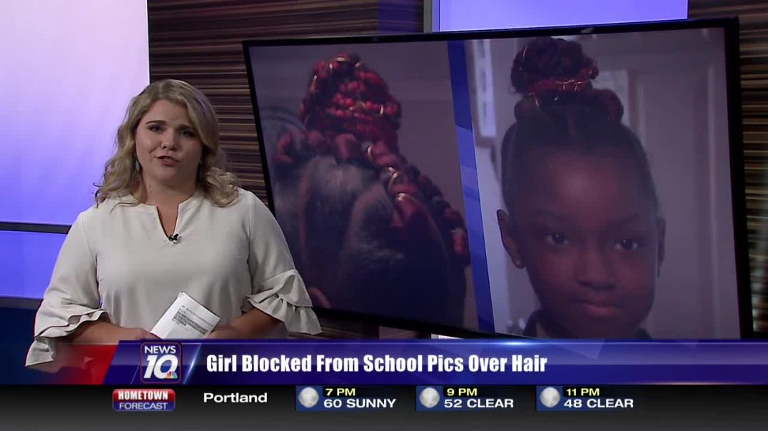 Eight-year-old girl denied school picture because of her hair